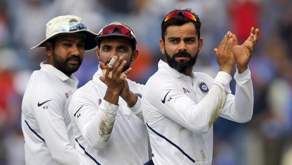 India's cricket team captain Virat Kohli, right, celebrates with teammates after winning the second test match against South Africa.