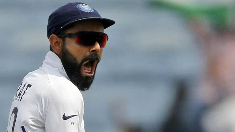 India's Virat Kohli celebrates celebrates the wicket of South Africa's Dean Elgar during the fourth day of second cricket test match between India and South Africa in Pune, India, Sunday, Oct. 13, 2019.
