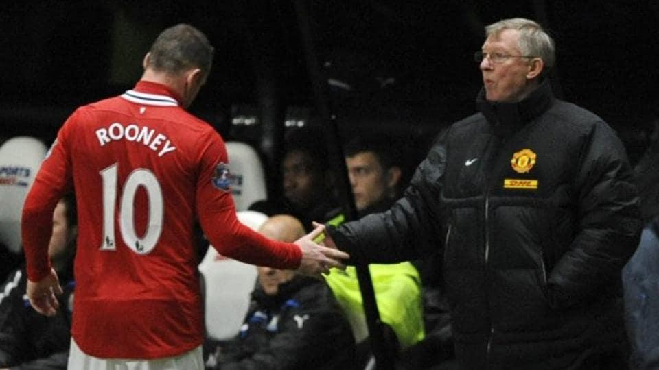 File photo of Sir Alex Ferguson with Wayne Rooney.