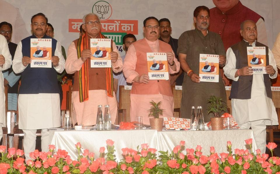 BJP leaders JP Nadda and Haryana Chief Minister Manohar Lal Khattar release the party's manifesto ahead of Haryana Assembly elections at The Lalit Hotel in Chandigarh.