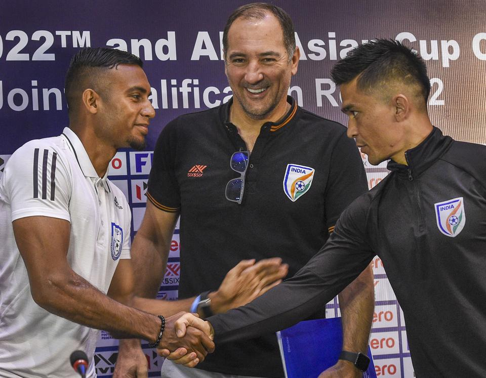 Indian football team captain Sunil Chhetri with coach Igor Stimac and Bangladesh team captain Jamal Bhuiyan during a press conference.