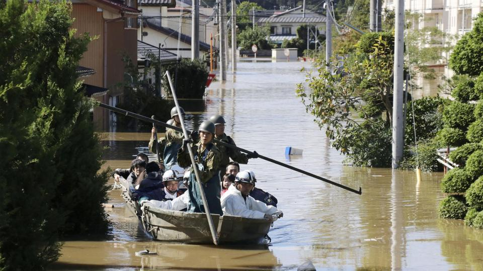 Local residents are rescued by Japapnese Defence-Force soldiers from a flooded area caused by Typhoon Hagibis in Kakuda, Miyagi prefecture, Japan