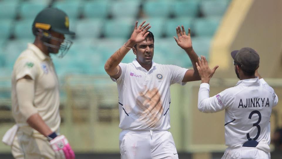 Ravichandran Ashwin celebrates with teammate Ajinkya Rahane during the 1st test match against South Africa in Visakhapatnam.
