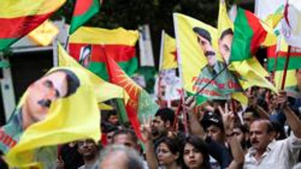 Kurds living in Greece and Greek protesters take part in a demonstration against Turkey's military action in northeastern Syria, in Athens, Greece.