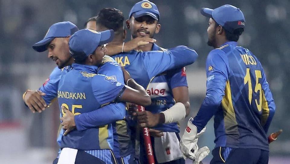 Sri Lankan players celebrate their victory against Pakistan