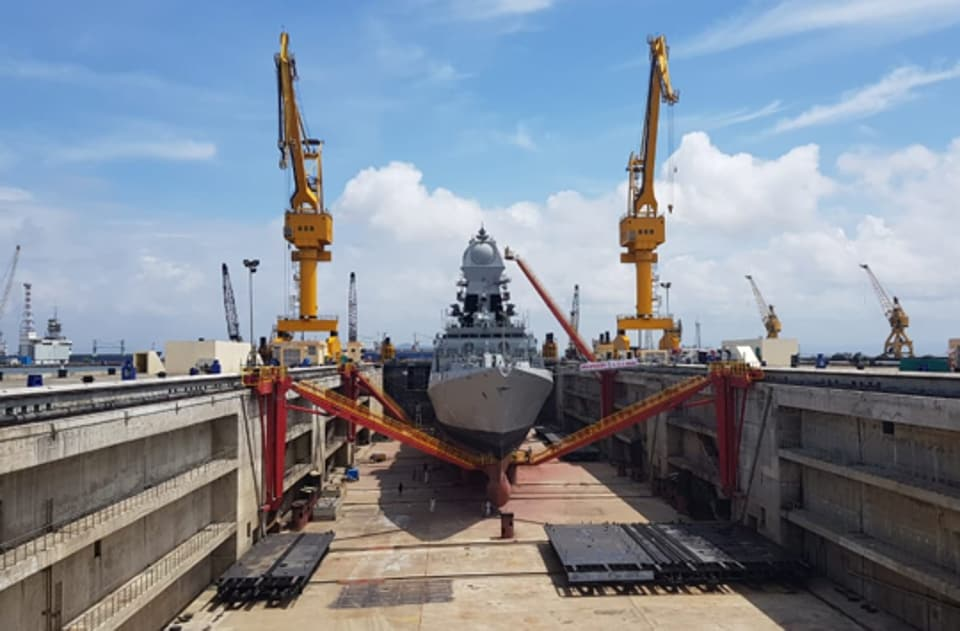 The Aircraft Carrier Dock, capable of accommodating INS Vikramaditya, IAC-I, the indigenous Aircraft Carrier, is under construction at Cochin Shipyard Limited and ships with tonnage upto 90000 tonnes, making it the largest dry dock of the Indian Navy. The commentary has been written by Li Ning and Wan Songjing, and carried on China Military Online.