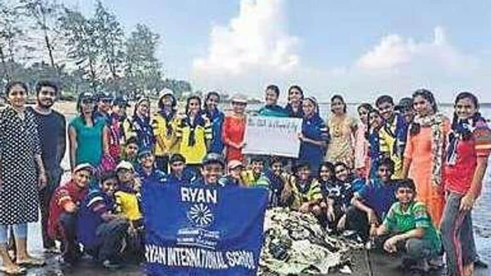 Students take part in beach clean-up drive.