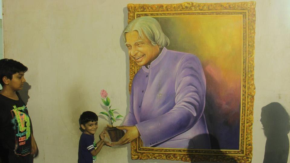 Children take selfie with former Indian President APJ Abdul Kalam's 3D painting at Amusement Park in Borivali, Mumbai.