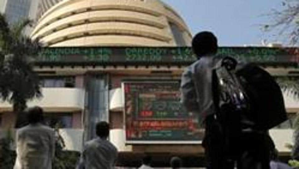 Screen displaying the Sensex results on the facade of the Bombay Stock Exchange (BSE) building in Mumbai.