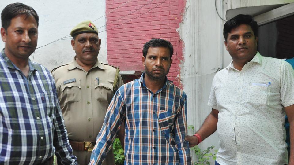 The suspect in police custody.