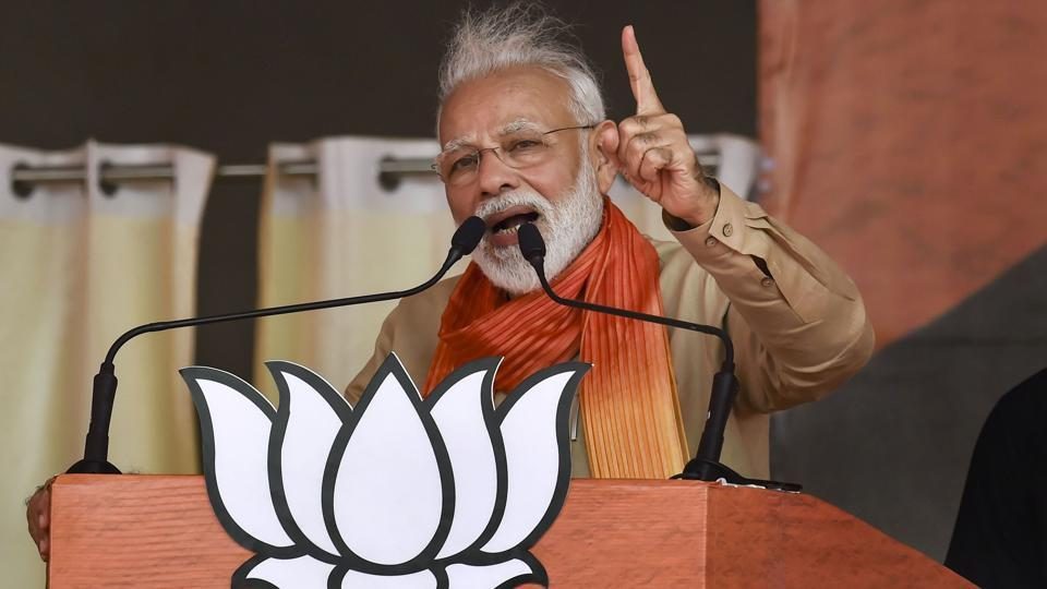 Prime Minister Narendra Modi addresses an election campaign rally ahead of Haryana Assembly elections, in Charkhi Dadri, Tuesday, Oct. 15, 2019.