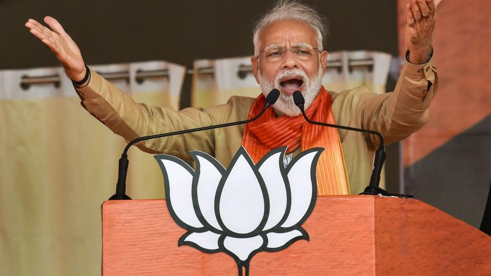 Prime Minister Narendra Modi addresses an election campaign rally ahead of Haryana Assembly elections, in Haryana.