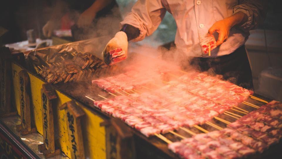 Man grilling meat. (Representational Image)