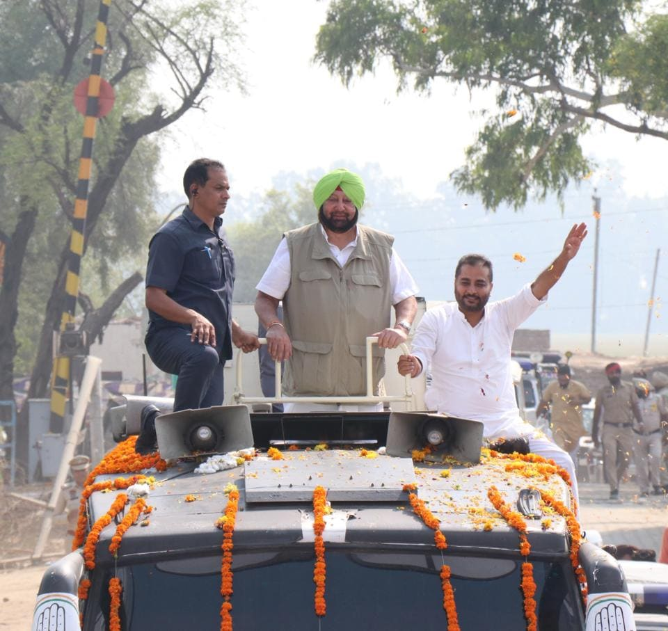 Punjab chief minister Captain Amarinder Singh during a roadshow in support of Congress candidate Raminder Singh Awla in Jalalabad on Wednesday.