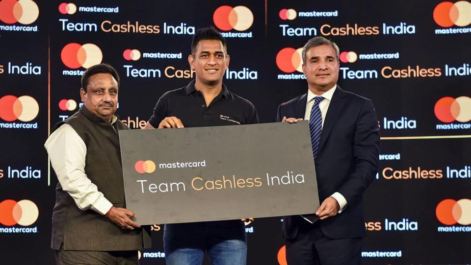 https://www.hindustantimes.com/rf/image_size_960x540/HT/p2/2019/10/16/Pictures/cashless-dhoni-india-the-launch-of-team_5b56b0a6-f011-11e9-a269-0317b040ce03.jpg