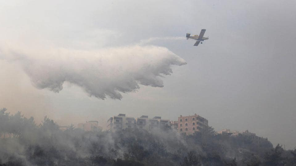 Fire crews were overwhelmed by the flames, forcing the Interior Ministry to send riot police with engines equipped with water cannons to help. Two small aircraft were sent from the nearby Mediterranean island of Cyprus to help put out the flames. The state has been widely criticized by residents because Lebanon bought three aircraft years ago to be used in extinguishing fires but they are parked at Beirut's airport with no money to maintain them. (Aziz Taher / REUTERS)