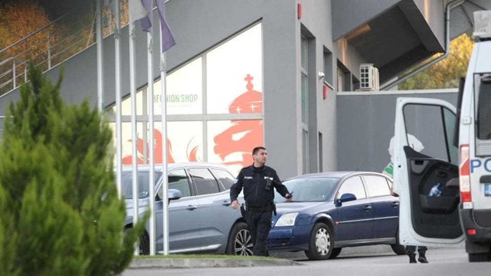 A police officer is seen outside the headquarters of the Bulgarian Football Union.