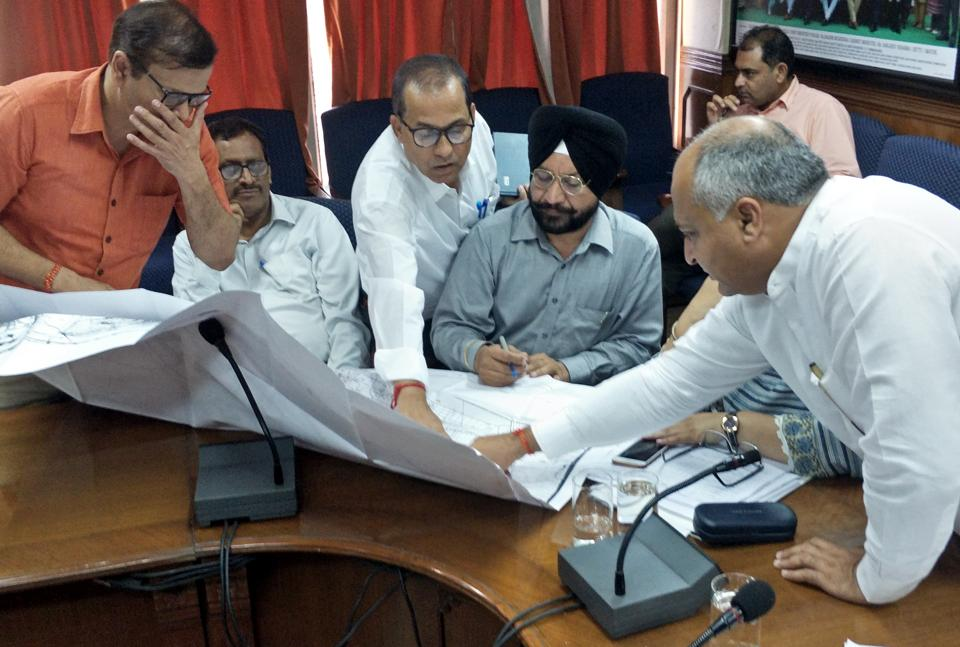 Mayor Sanjeev Sharma Bittu interacting with officials during the meeting at MC office in Patiala on Wednesday.