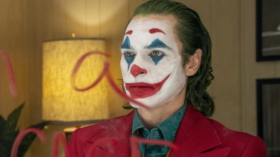 This image released by Warner Bros. Pictures shows Joaquin Phoenix in a scene from the film, Joker.
