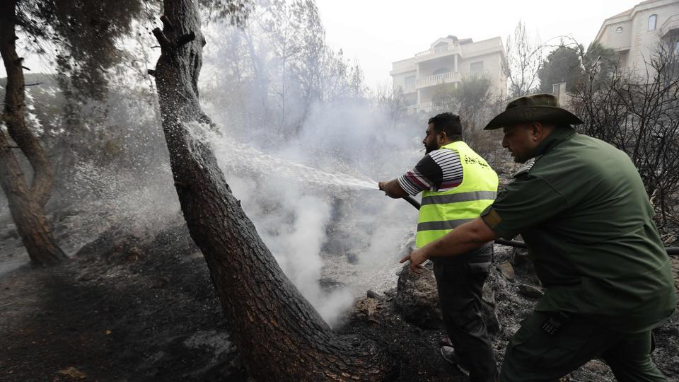 A heat wave in the region coupled with strong winds intensified the fires that began a day earlier in mostly pine forests around the country and three provinces in neighbouring Syria. (Joseph Eid / AFP)
