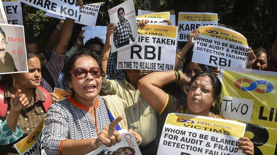 Depositors of the Punjab and Maharashtra Co-operative Bank (PMC) display placards during a protest over the Reserve Bank of India (RBI)'s curb on the bank, outside Esplanade court in Mumbai on Wednesday.