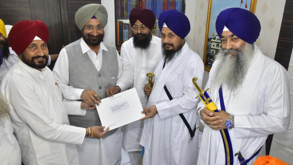 Two state cabinet ministers — Sukhjinder Singh Randhawa (jails and cooperation) and Charanjit Singh Channi (technical educational & industrial training) who are representing the government in the coordination committee formed by the Akal Takht for the joint event — on Tuesday morning met acting Akal Takht jathedar Giani Harpreet Singh and handed him over a letter of Punjab chief minister Amarinder Singh in a sealed envelope.