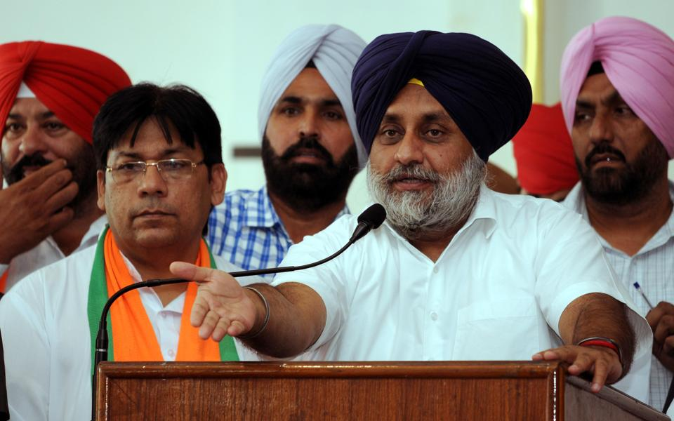 SAD president Sukhbir Badal along with SAD-BJP candidate Rajesh Bagha addressing the gethering during a political rally ahead of bypoll at Phagwara, India on Wednesday.