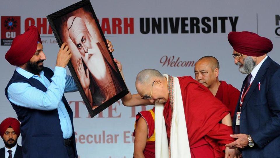 Chandigarh University chancellor Satnam Singh Sandhu welcoming The Dalai Lama at the university,  Gharuan campus, in Punjab on Tuesday.