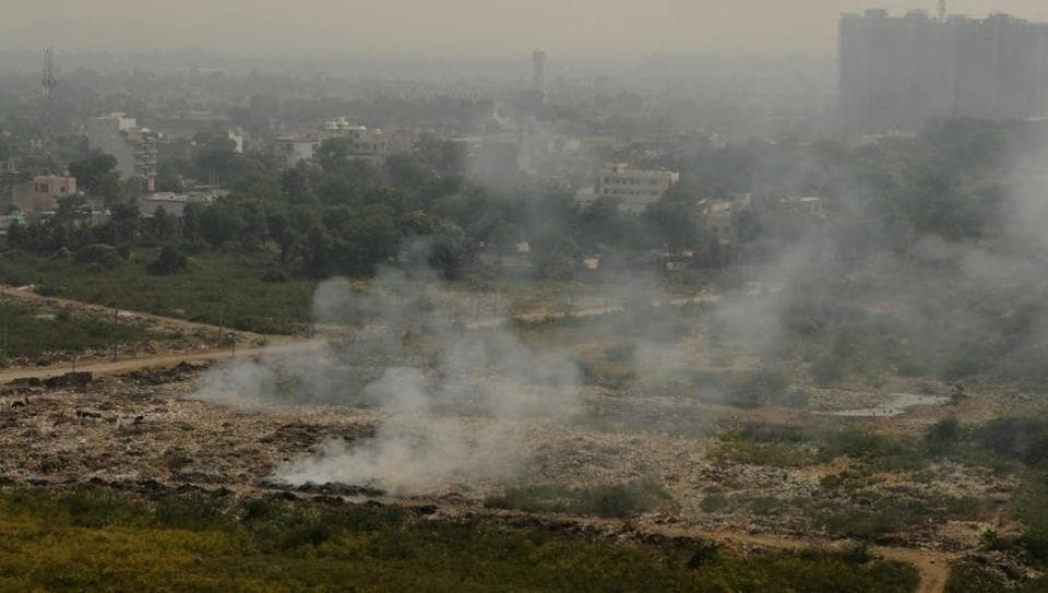 Smoke cloud seen as garbage is burnt  near Police station, at Sohna village, in Gurugram,  on Wednesday, October 16, 2019.