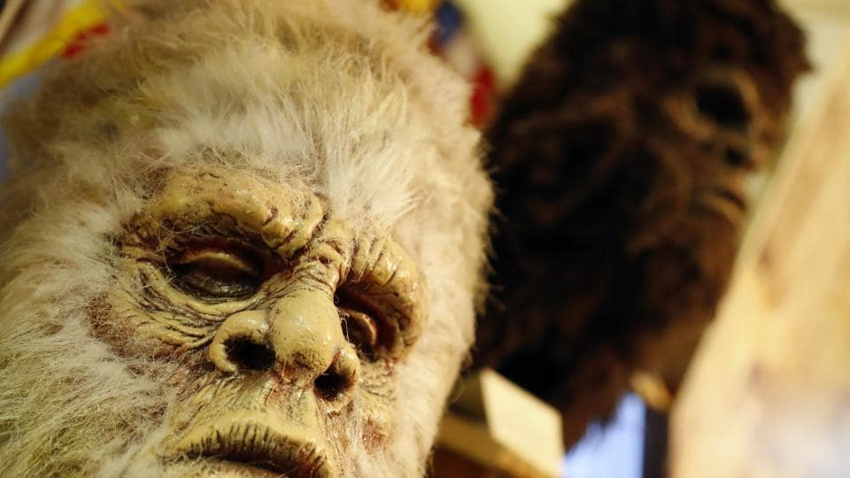 This Aug. 8, 2019, photo shows Bigfoot masks on display at Expedition: Bigfoot! The Sasquatch Museum in Cherry Log, Ga.