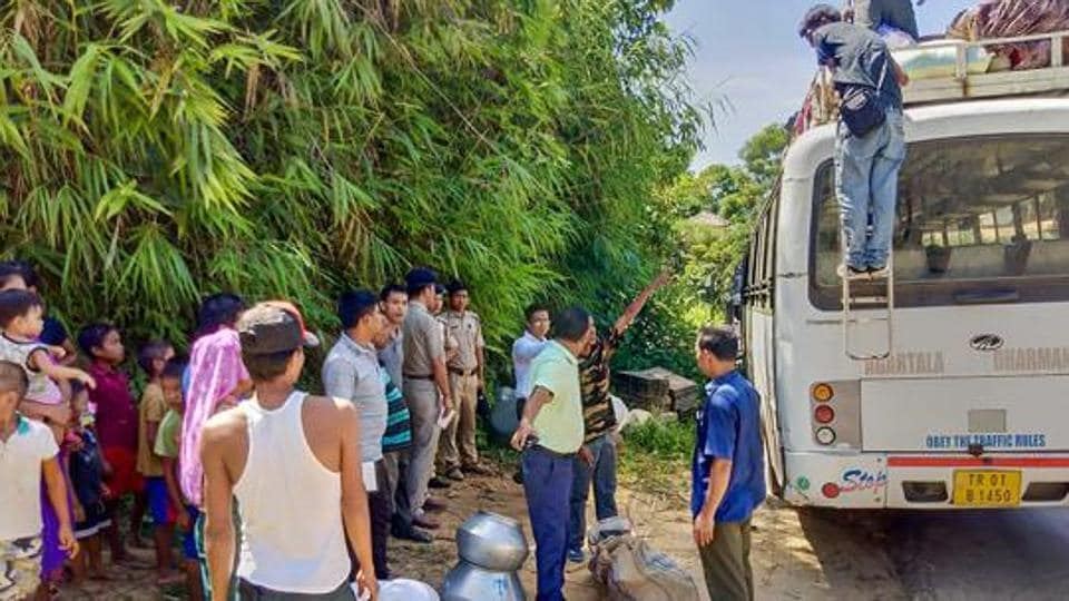 Displaced Bru refugee families board a bus to return to Mizoram from Tripura as part of a Home ministry sponsored rehabilitation package.