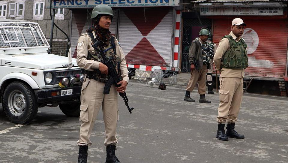 CRPF personnel stand guard at a market in Srinagar on Friday.