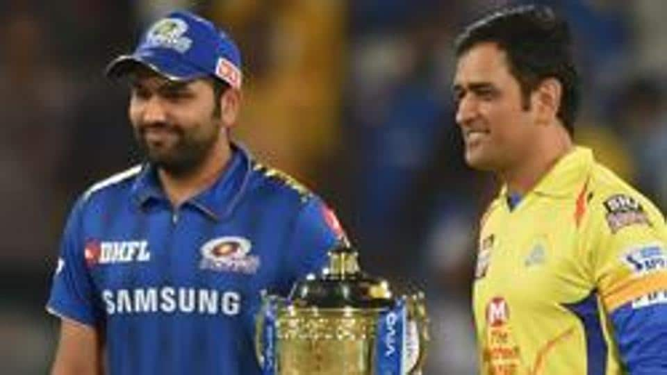 Rohit Sharma and MS Dhoni with the IPL trophy