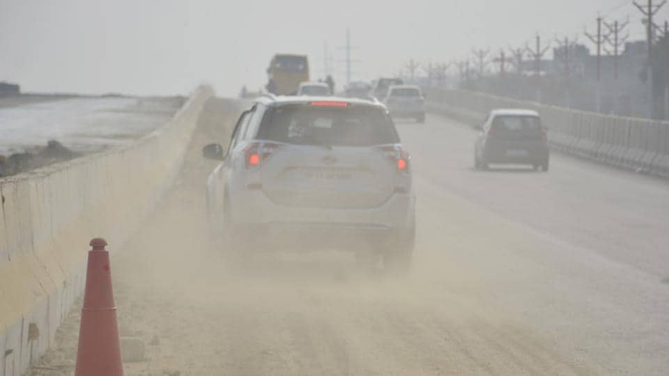 Passing vehicles raise dust along NH 9 Road in Ghaziabad, India on Wednesday, October 16, 2019.