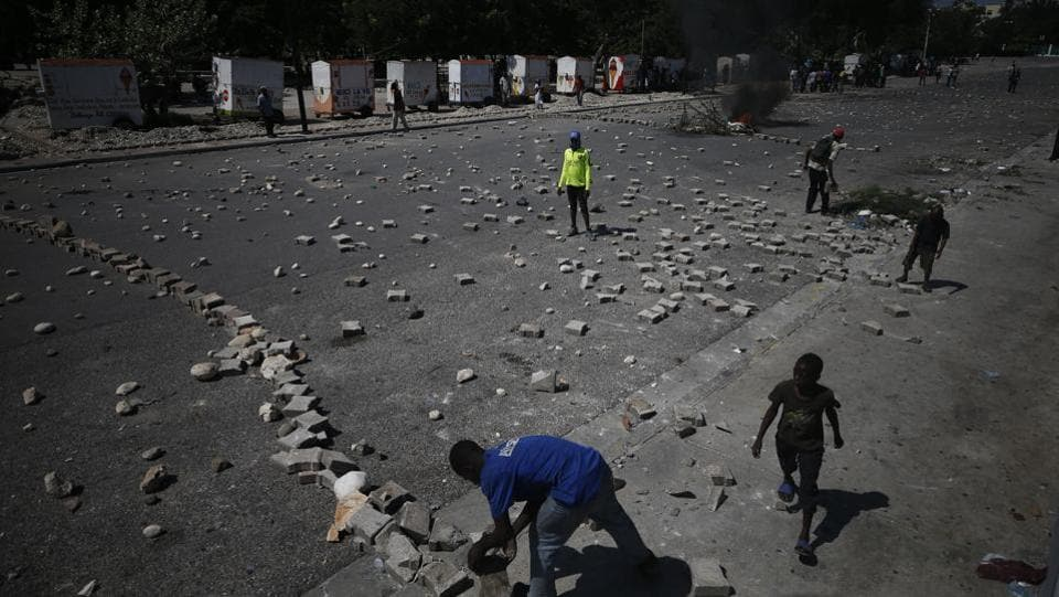 Protesters use paving stones and rocks to barricade a road near the presidential palace. A new budget hasn't been approved for two years, prompting organizations like the International Monetary Fund and others to withhold aid. On Tuesday the UN's Mission for Justice Support in Haiti ended its mandate, marking the first time since 2004 that there was no UN peacekeeping operation in Haiti. (Rebecca Blackwell / AP)