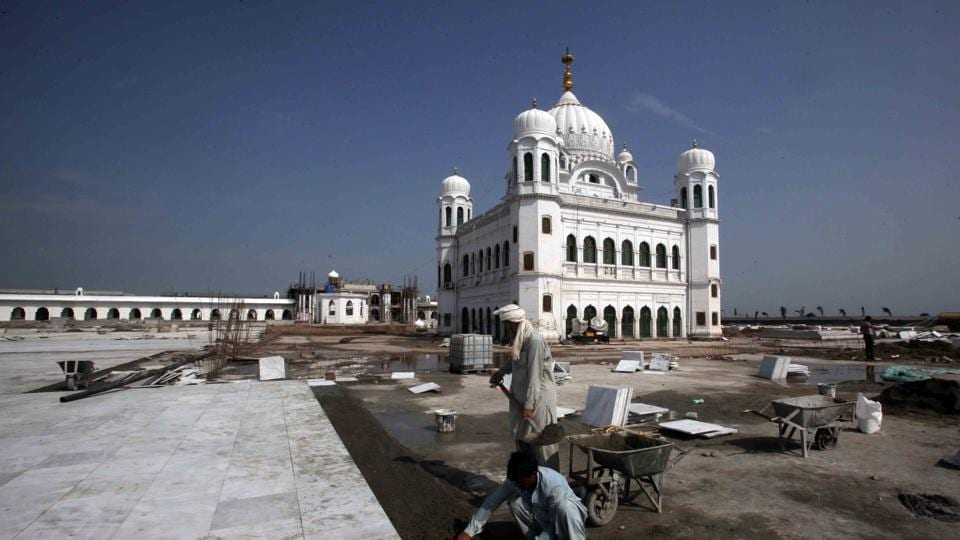 Laborers work at the sites of the Gurdwara Darbar Sahib, which will be open this year for Sikh pilgrims, in Kartarpur, Pakistan.