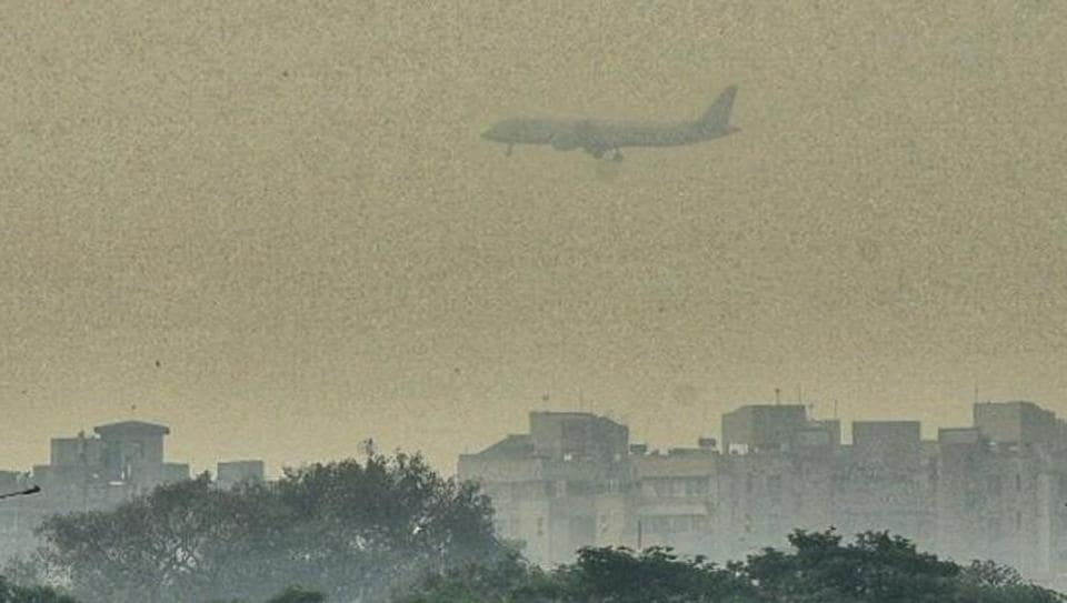 A passenger plane seen in the sky amid smog, at Dwarka, in New Delhi, on Thursday, October 17, 2019.
