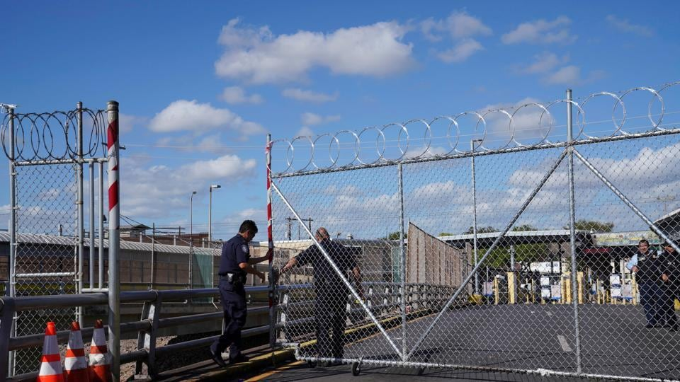 US Customs and Border Protection agents close down a gate near US-Mexico border.