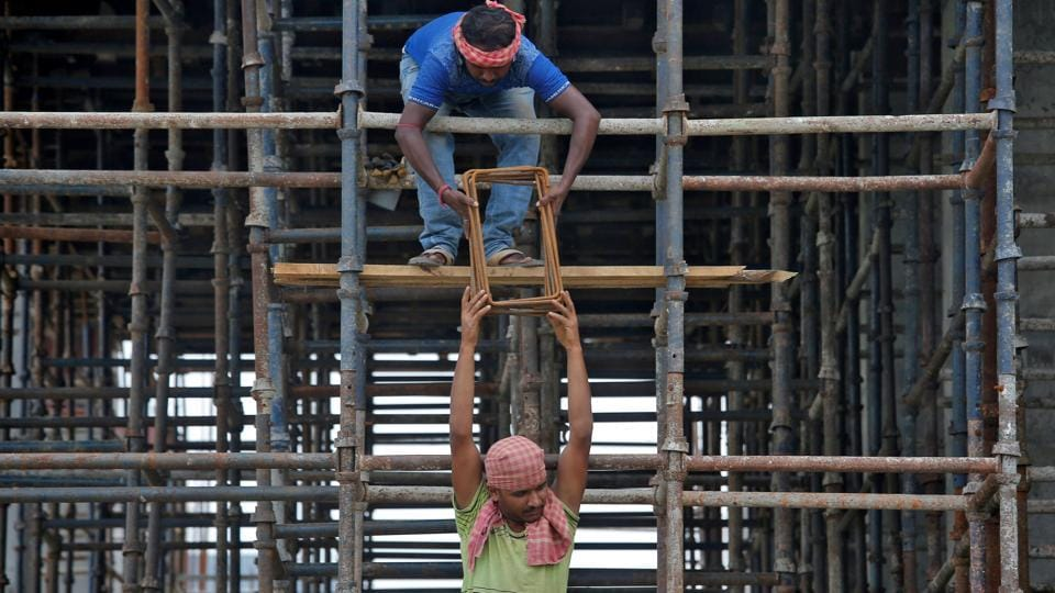 Labourers work at the construction site of a residential building on the outskirts of Kolkata, India.