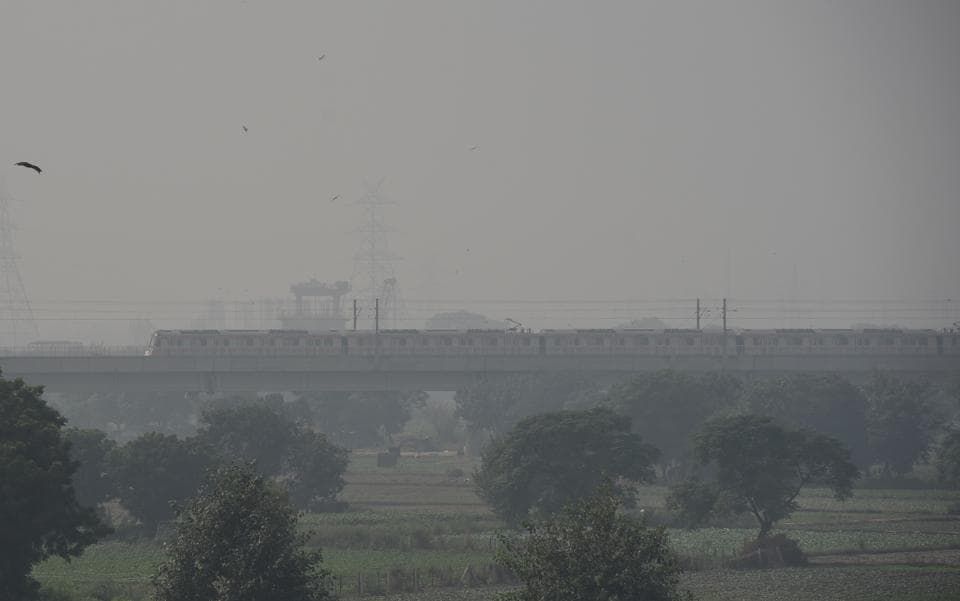 A view of the moving metro as smog engulfs the Delhi skyline.