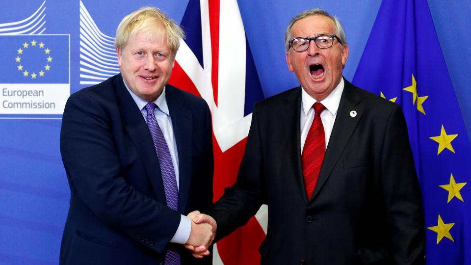 European Commission President Jean-Claude Juncker and Britain's Prime Minister Boris Johnson shake hands during a news conference after agreeing on the Brexit deal, at the sidelines of the European Union leaders summit, in Brussels, Belgium. (Francois Lenoir / REUTERS)