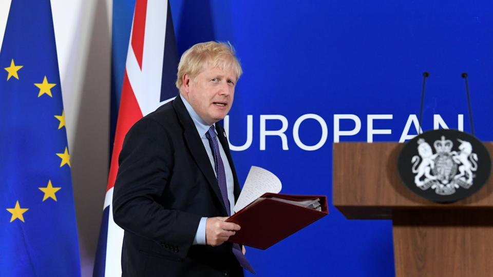 Britain's Prime Minister Boris Johnson arrives to speak at a news conference during the European Union leaders summit dominated by Brexit, in Brussels, Belgium.