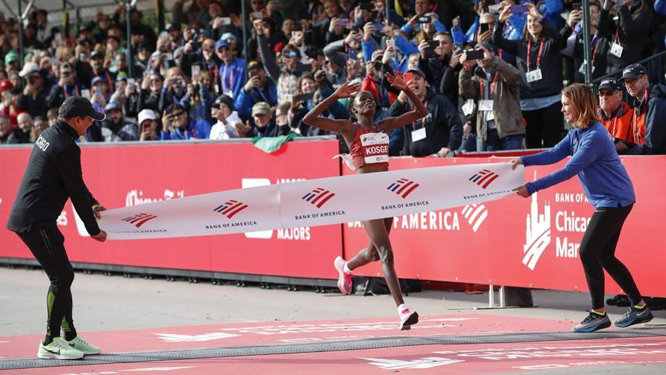 Kenya's Brigid Kosgei crosses the finish line as she wins the women's 2019 Bank of America Chicago Marathon with the World Record in Chicago, Illinois. Kosgei shattered Paula Radcliffe's 16-year-old world record, winning the Chicago Marathon in 2 hours, 14 minutes and 4 seconds. Kosgei broke the mark of 2:15:25 set by Radcliffe in the London Marathon on April 13, 2003. (Kamil Krzaczynski / AFP)