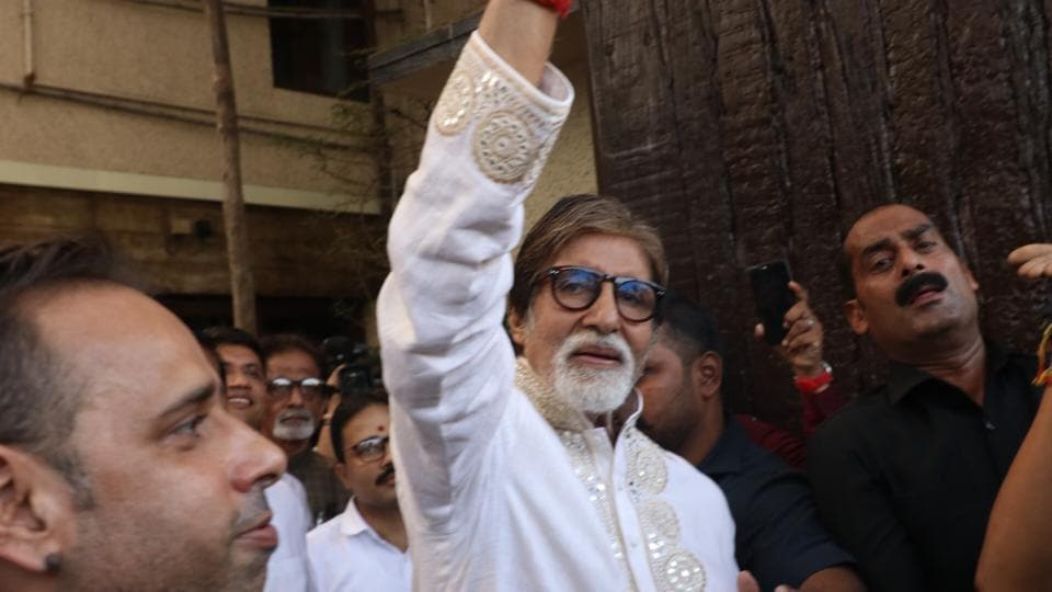 Amitabh Bachchan greets fans who gathered outside his residence Prateeksha to wish him on his 77th birthday in Mumbai on Oct 11, 2019.