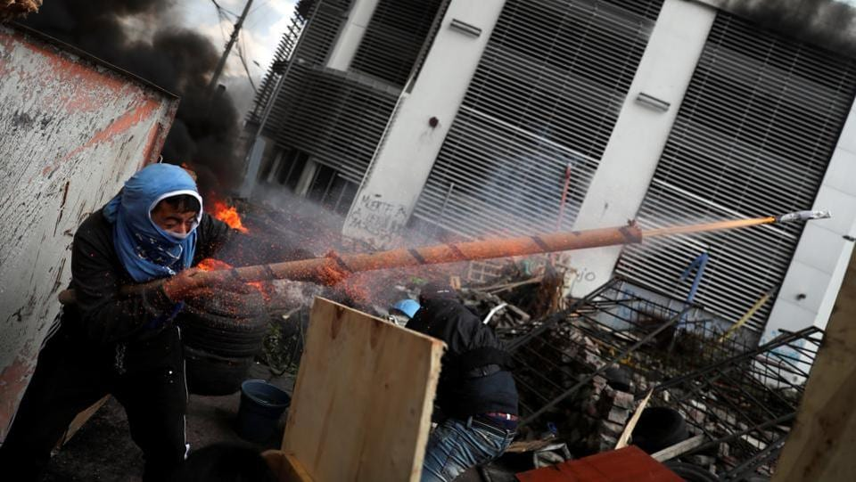 A demonstrator fires a homemade weapon during a protest against Ecuador's President Lenin Moreno's austerity measures in Quito, Ecuador. (Ivan Alvarado / REUTERS)