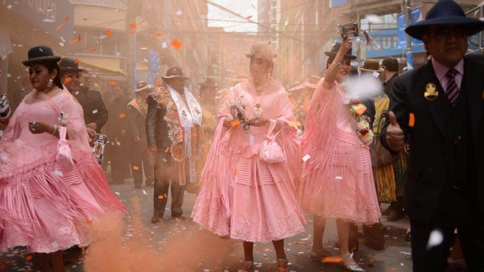Dancers from a preste celebration shoot confetti in Eloy Salmon Street in Zona Gran Poder, La Paz, Bolivia. Bolivian leader Evo Morales came to power in 2006 with a pledge to champion marginalized indigenous groups including his own important Andean tribe the Aymara, which helped carry him to the presidency. (Manuel Seoane / REUTERS)