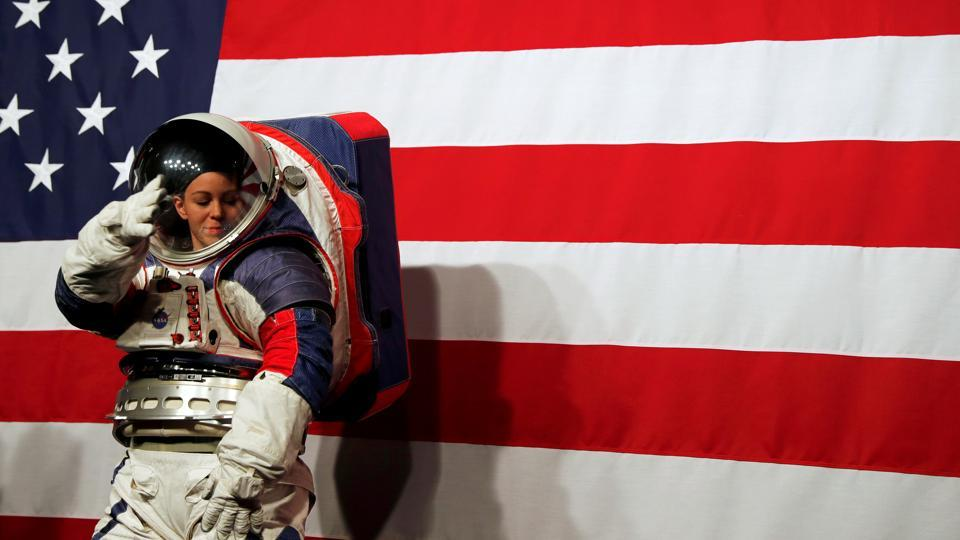 Advanced Space Suit Engineer at NASA Kristine Davis wears the xEMU prototype space suit for the next astronaut to the moon by 2024, during its presentation at NASA headquarters in Washington. (Carlos Jasso / REUTERS)