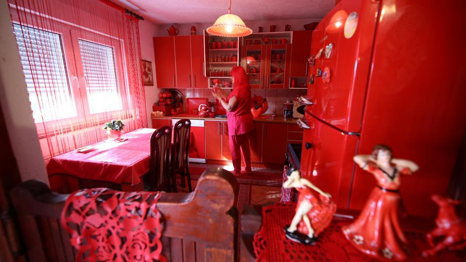 Zorica Rebernik, obsessed with the red color, stands in the kitchen inside her house in the village of Breze near Tuzla, Bosnia and Herzegovina. (Dado Ruvic / REUTERS)