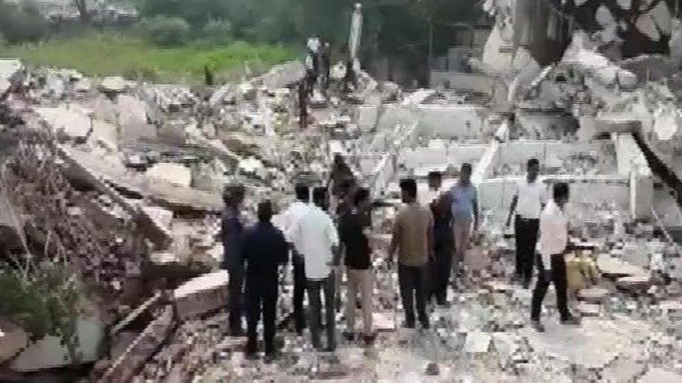 A building which was being demolished in Gujarat's Vadodara city collapsed trapping several labourers.