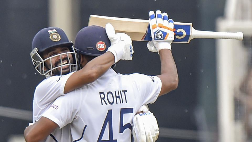 Ranchi: Indian cricketer Rohit Sharma celebrates after scoring 100 runs with teammate Ajinkya Rahane.